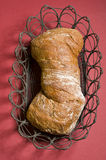 Loaf of  bread over color background Royalty Free Stock Photo