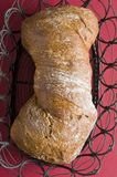 Loaf of  bread over color background Royalty Free Stock Images
