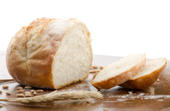 Loaf of bread, partly sliced stock photography