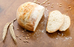 Loaf of bread, partly sliced Royalty Free Stock Photography