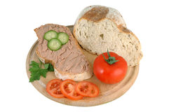 Loaf of bread with pate. And vegetables on wooden cutting board Royalty Free Stock Photography