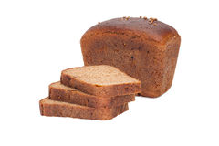 Loaf of bread and pieces of rye-bread. Is isolated on a white background Stock Images