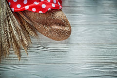 Loaf of bread polka-dot tablecloth wheat ears on vintage wooden Royalty Free Stock Photography