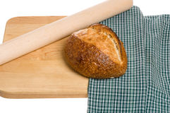 Loaf of bread and rolling pin Royalty Free Stock Photography