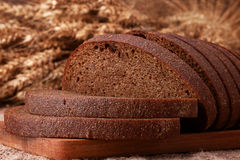 Loaf of bread and rye ears still life Royalty Free Stock Image