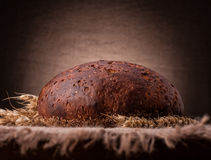 Loaf of bread and rye ears still life Stock Photos