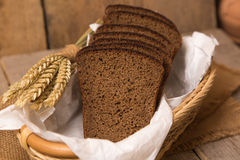 Loaf of bread and rye ears Royalty Free Stock Photo