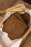 Loaf of bread and rye ears Stock Photos