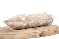Loaf of bread with sausages on wooden plate Royalty Free Stock Images