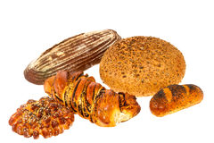 Loaf of bread with sesame seeds and roll with poppy seeds Royalty Free Stock Photo