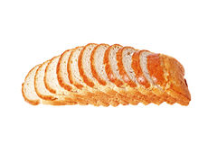 Loaf of bread sliced ??. Isolated on a white background Royalty Free Stock Photos