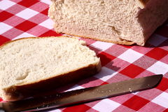Loaf of bread sliced. Photograph of a loaf of bread sliced with knife Royalty Free Stock Image