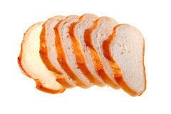 A loaf of bread sliced. Isolated on a white background Stock Photo