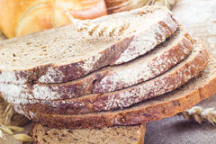 Loaf bread sliced with crispy rolls Royalty Free Stock Image