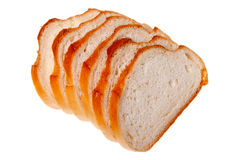 A loaf of bread sliced (isolated). A loaf of bread sliced, isolated on a white background Stock Photo