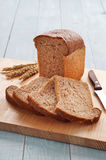 Loaf of bread with sliced pieces of bread Royalty Free Stock Photography