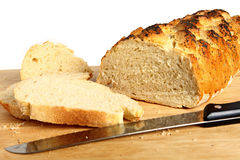 Loaf of bread with slices Stock Photography