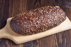 Loaf of bread with sunflower seeds Stock Images