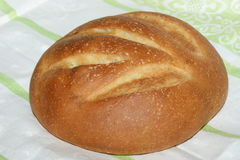 Loaf of bread on tablecloth Stock Photos