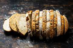 Loaf of bread in two alternating cereals. Loaf of bread formed of two alternating cereals with alternate slices of rye and wholewheat breads viewed from above Royalty Free Stock Photo
