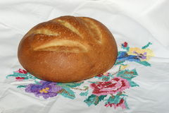 Loaf of bread on vintage tablecloth Royalty Free Stock Image