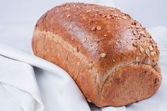 Loaf of bread on white linen. Close up Stock Photography
