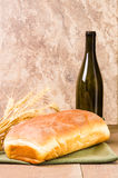 Loaf of bread with wine bottle Royalty Free Stock Photos