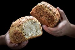 Loaf of bread in woman`s hands stock images