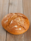 Loaf of bread on wood Royalty Free Stock Photos