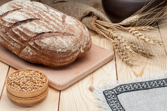Loaf of bread on wooden table Stock Images