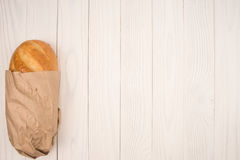 Loaf of bread on a wooden white table. Stock Photo