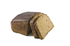 Loaf of brown bread and hunches of bread isolated against white Royalty Free Stock Photo