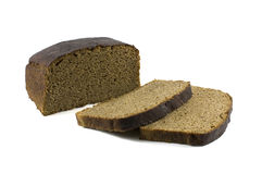 Loaf of brown bread and hunches of bread isolated against white Stock Photography