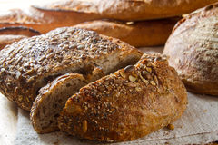 Loaf of brown multigrain bread Stock Images