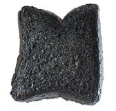 Loaf of burnt bread Stock Photos