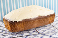 Loaf cake with cream cheese icing. Home made loaf cake with cream cheese icing royalty free stock photos