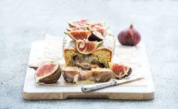 Loaf cake with figs, almond and white chocolate on Stock Images