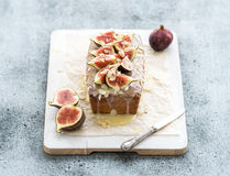 Loaf cake with figs, almond and white chocolate on Royalty Free Stock Image
