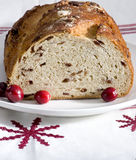 Loaf of cranberry bread. Fresh loaf of cranberry bread on holiday themed napkin Royalty Free Stock Photography