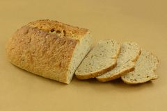 Loaf of Focaccia bread. Baked loaf of Focaccia bread with sesame seeds with some slices cut royalty free stock images