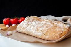 Loaf of fresh bread on the table royalty free stock images