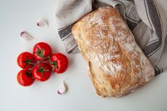 Loaf of fresh bread on the table royalty free stock photo