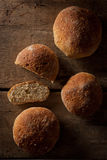 Loaf of fresh bread on a wood background Stock Images
