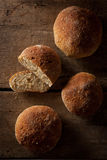 Loaf of fresh bread on a wood background Stock Image