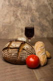 Loaf of fresh rye bread on a table Stock Photo