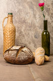 Loaf of fresh rye bread with wine bottle Royalty Free Stock Photography