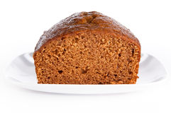 Loaf of freshly baked pumkin bread. Closeup of loaf of freshly baked pumpkin bread on isolating background Stock Image