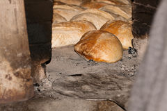 Loaf of freshly bread being cooked. In a traditional oven Stock Photo