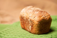 Loaf of grey wheat rye bread on napkin Royalty Free Stock Image