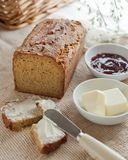 A loaf of home made paleo bread with butter and jam. royalty free stock image